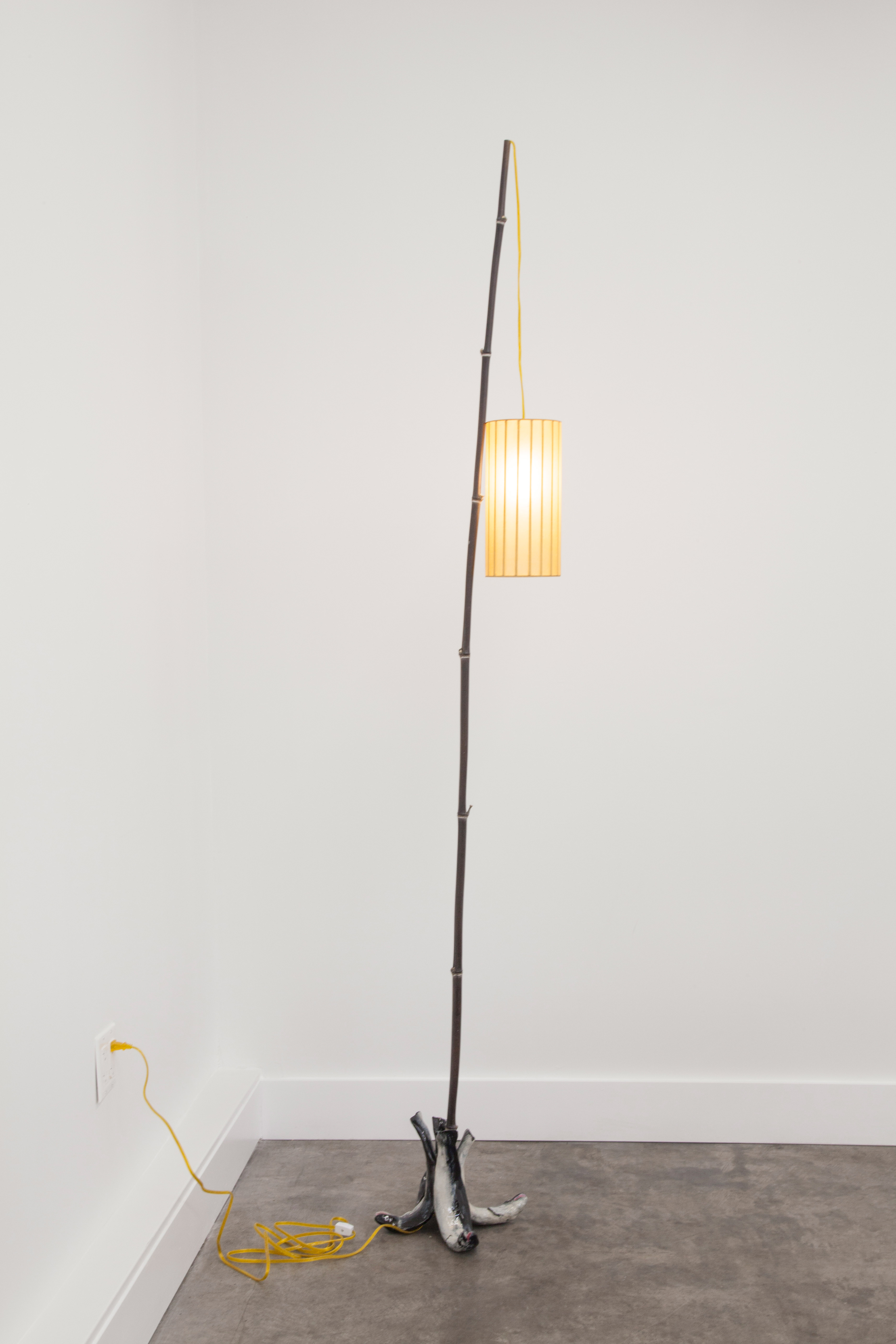 Electrical hardware, cord, bamboo, laquer, paper, light bulb, socket, glazed ceramic, hot glue, wood approx. 24 x 102 in